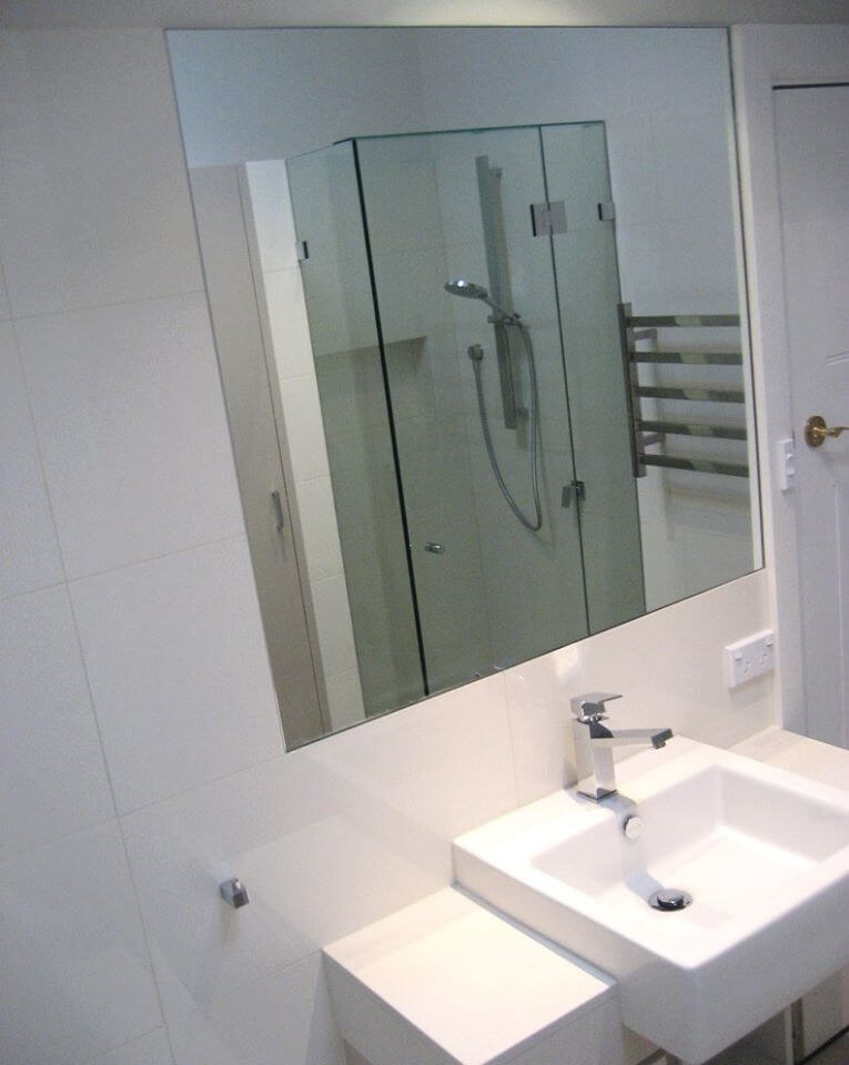 simple bathroom mirror above basin